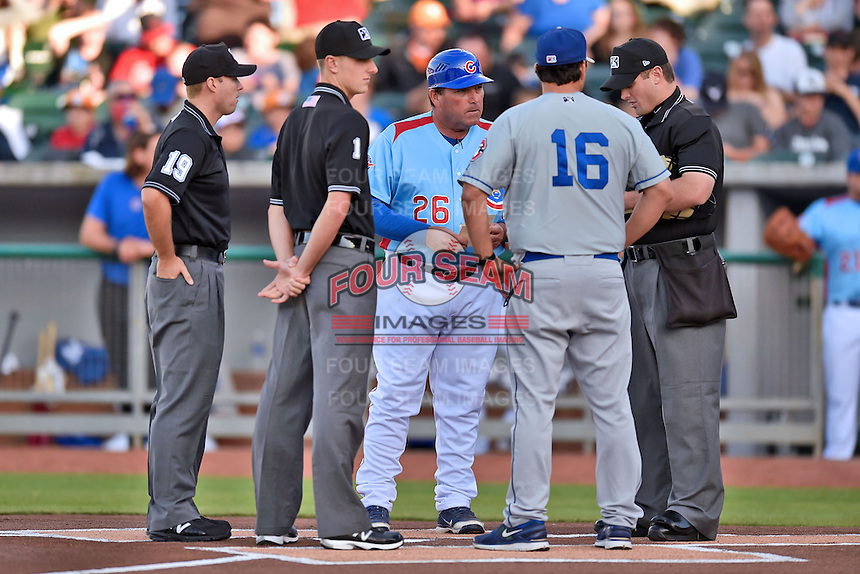 First base umpire Lew Williams (19), third base umpire Alex Ransom (1),  Tennessee Smokies manager Buddy Baily (26), Chattanooga Lookouts manager Doug Mientkiewicz (16) and  home plate umpire Blake Carnahan before a game against the Chattanooga Lookouts on April 25, 2015 in Kodak, Tennessee. The Smokies defeated the Lookouts 16-10. (Tony Farlow/Four Seam Images)