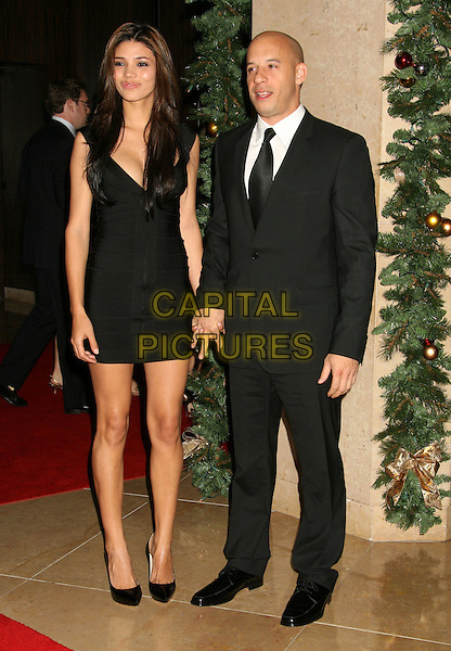 GUEST & VIN DIESEL.23rd Annual American Cinematheque Awards held at the Beverly Hilton Hotel, Beverly Hills, California, USA..December 1st, 2008.full length black suit dress holding hands .CAP/ADM/MJ.©Michael Jade/AdMedia/Capital Pictures.