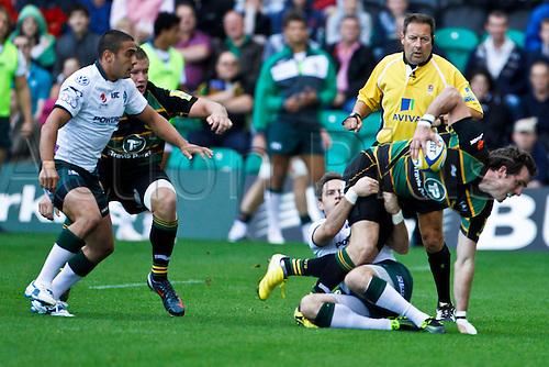 11.09.2011 Aviva Premiership Rugby Union from Franklins Gardens. Northampton Saints v London Irish.  Jon Clarke is tackled by Darren Allinsion.  Final score: Northampton Saints 13-14 London Irish.