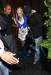 5-1-08.A very drunk Christina Aguilera being held up by her husband. Another one of her friends had to help her into the car. It was the grand opening of a new club called The Crown BAR in Hollywood...www.abilityfilms.com 805-427-3519.abilityfilms@yahoo.com