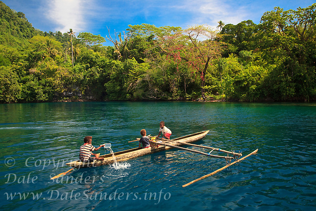 In the Witu Islands off New Britain Island in Papua New Guinea, young children learn to paddle an outrigger canoe almost before they can walk. These children paddle their outrigger canoe inside the flooded crater of an ancient volcano on Garove Island.