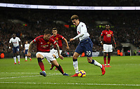 Tottenham Hotspur's Dele Alli takes on Manchester United's Victor Lindelof<br /> <br /> Photographer Rob Newell/CameraSport<br /> <br /> The Premier League - Tottenham Hotspur v Manchester United - Sunday 13th January 2019 - Wembley Stadium - London<br /> <br /> World Copyright &copy; 2019 CameraSport. All rights reserved. 43 Linden Ave. Countesthorpe. Leicester. England. LE8 5PG - Tel: +44 (0) 116 277 4147 - admin@camerasport.com - www.camerasport.com