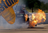 Apr. 26, 2013; Baytown, TX, USA: Flames come from the headers on the funny car of NHRA driver Jeff Arend during qualifying for the Spring Nationals at Royal Purple Raceway. Mandatory Credit: Mark J. Rebilas-