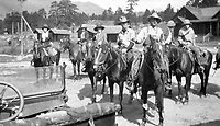 Five women and two men on horseback in a small western United States town and ready to ride, circa 1930's.   (photo: www.bcpix.com)