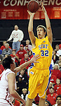 VERMILLION, SD - FEBRUARY 9: Marcus Heemstra #32 from South Dakota State shoots over the defense of Ricardo Andreotti #14 from the University of South Dakota in the first half of their game Thursday night at the DaktaDome in Vermillion, SD. (Photo by Dave Eggen/Inertia)