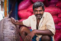 Portrait photo of a worker at Dambulla vegetable market, Dambulla, Central Province, Sri Lanka, Asia. This is a portrait photo of a worker at Dambulla vegetable market, Dambulla, Central Province, Sri Lanka, Asia.