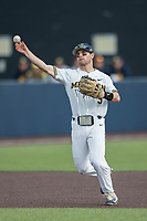 Michigan Wolverines shortstop Michael Brdar (9) makes a throw to first base against the Michigan State Spartans during the NCAA baseball game on April 18, 2017 at Ray Fisher Stadium in Ann Arbor, Michigan. Michigan defeated Michigan State 12-4. (Andrew Woolley/Four Seam Images)