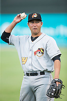 Francisco Diaz (44) of the West Virginia Power warms up in the outfield prior to the game against the Kannapolis Intimidators at Intimidators Stadium on July 3, 2015 in Kannapolis, North Carolina.  The Intimidators defeated the Power 3-0 in a game called in the bottom of the 7th inning due to rain.  (Brian Westerholt/Four Seam Images)