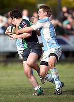 Ballynahinch flanker Willie Faloon is tackled by Mike Sherry during the AIB Cup semi-final against Garryowen at Ballymacarn Park, Ballynahinch. Mandatory Credit - John Dickson
