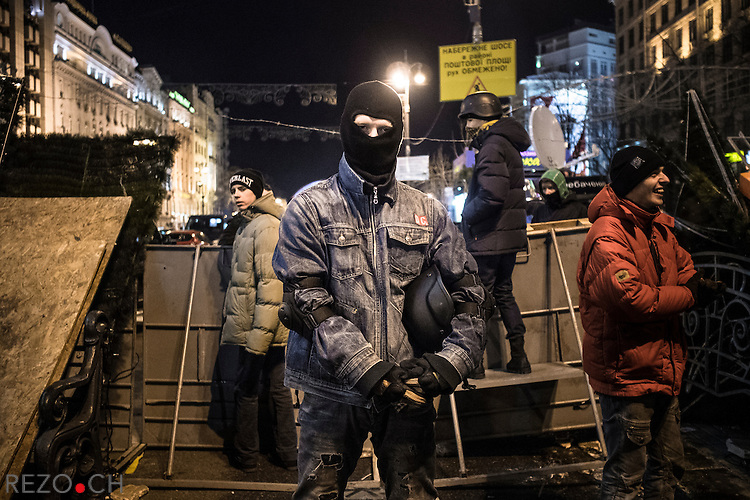 Kiev, Ukraine - 03 december 2013: Rem, a nationalist volunteered to guard one of the barricade blocking the potential police offensive against euromaidan. Credit: Niels Ackermann / Rezo.ch