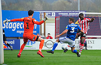 Macclesfield Town's Kieran O'Hara, left, and Macclesfield Town's David Fitzpatrick combine to prevent Lincoln City's John Akinde scoring<br /> <br /> Photographer Chris Vaughan/CameraSport<br /> <br /> The EFL Sky Bet League Two - Lincoln City v Macclesfield Town - Saturday 30th March 2019 - Sincil Bank - Lincoln<br /> <br /> World Copyright © 2019 CameraSport. All rights reserved. 43 Linden Ave. Countesthorpe. Leicester. England. LE8 5PG - Tel: +44 (0) 116 277 4147 - admin@camerasport.com - www.camerasport.com