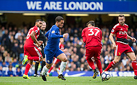 Eden Hazard of Chelsea takes on Watford players during the Premier League match between Chelsea and Watford at Stamford Bridge, London, England on 21 October 2017. Photo by Andy Rowland.