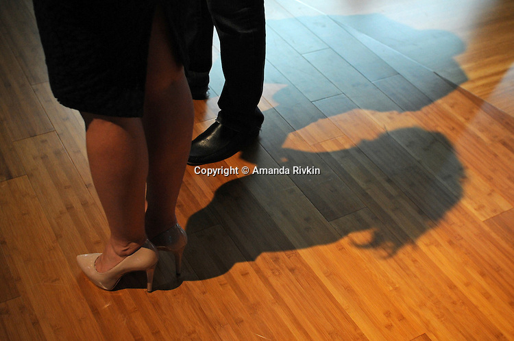 The swollen ankles of a model for Fisker are seen at at the Detroit Auto Show in Detroit, Michigan on January 12, 2009.