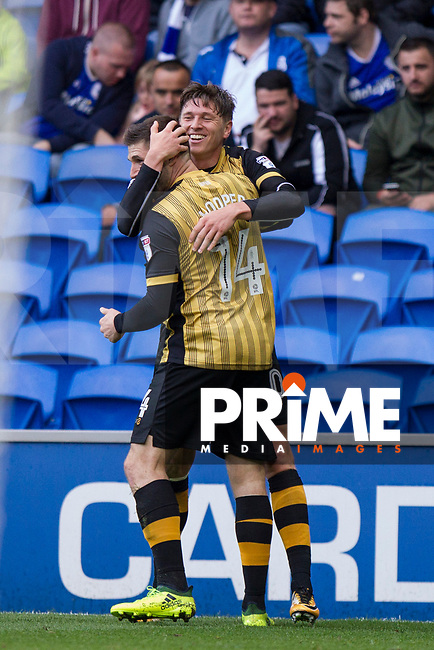 Gary Hooper of Sheffield Wednesday celebrates scoring his side's opening goal with Adam Reach during the Sky Bet Championship match between Cardiff City and Sheffield Wednesday at Cardiff City Stadium, Cardiff, Wales on 16 September 2017. Photo by Mark  Hawkins / PRiME Media Images.