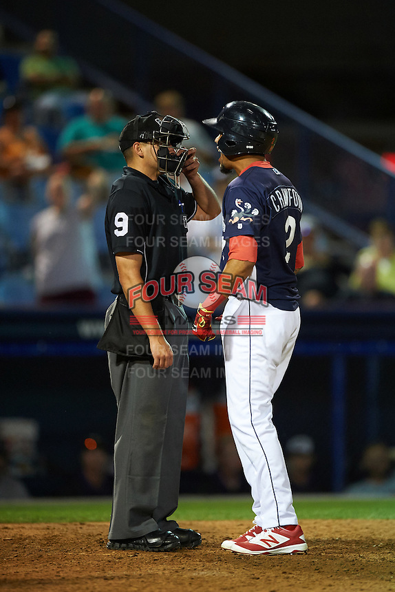 Reading Fightin Phils shortstop J.P. Crawford (2) argues a strike three call with umpire Paul Clemons during a game against the New Britain Rock Cats on August 7, 2015 at FirstEnergy Stadium in Reading, Pennsylvania.  Reading defeated New Britain 4-3 in ten innings.  (Mike Janes/Four Seam Images)