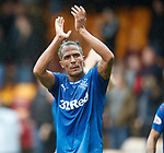 Bruno Alves applauds the Rangers fans