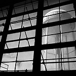 A water tower is seen through a window in a closed Chrysler assembly plant in Newark, Delaware. The plant once served as a major employer in northern Delaware and has since been demolished.