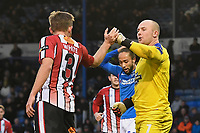 Andy White of Altrincham left congratulates Altrincham  keeper Tony Thompson of Altrincham on making a save during Portsmouth vs Altrincham, Emirates FA Cup Football at Fratton Park on 30th November 2019