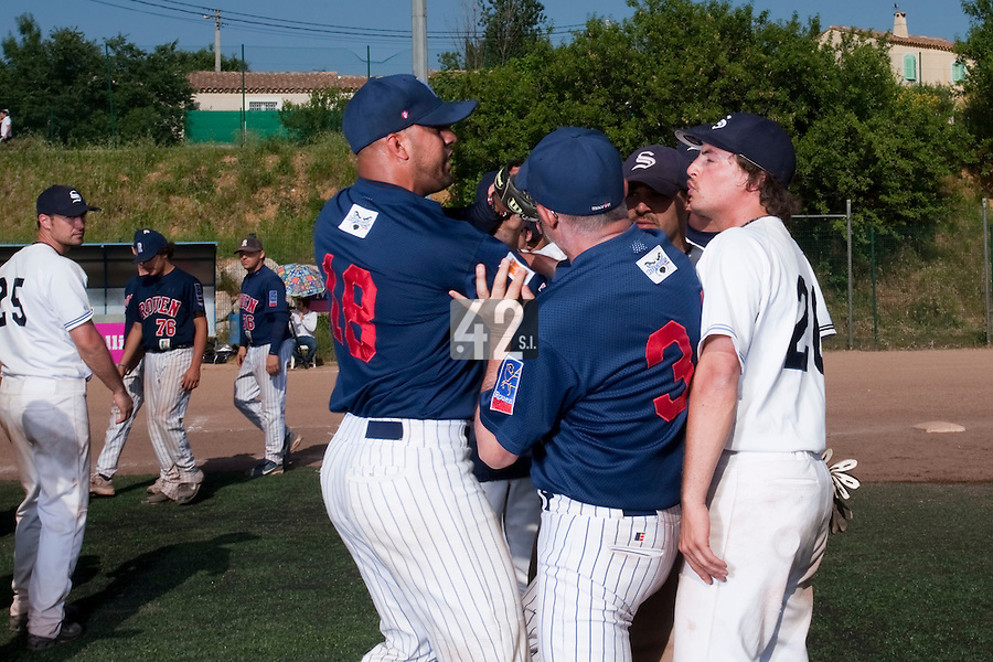 24 May 2009: Keino Perez of Rouen exchanges words with Romain Scott-Martinez of Savigny during the 2009 challenge de France, a tournament with the best French baseball teams - all eight elite league clubs - to determine a spot in the European Cup next year, at Montpellier, France. Rouen wins 7-5 over Savigny.