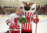 Wisconsin Badgers Kelly Jaminski (7) with mascot Bucky Badger during an NCAA college women's hockey game against the Minnesota Golden Gophers Friday, February 14, 2014 in Madison, Wis. The Golden Gophers won 3-2. (Photo by David Stluka)