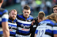 Scott Andrews, Charlie Ewels and Nick Auterac of Bath Rugby look dejected in a post-match huddle. Aviva Premiership match, between Bath Rugby and Newcastle Falcons on September 23, 2017 at the Recreation Ground in Bath, England. Photo by: Patrick Khachfe / Onside Images