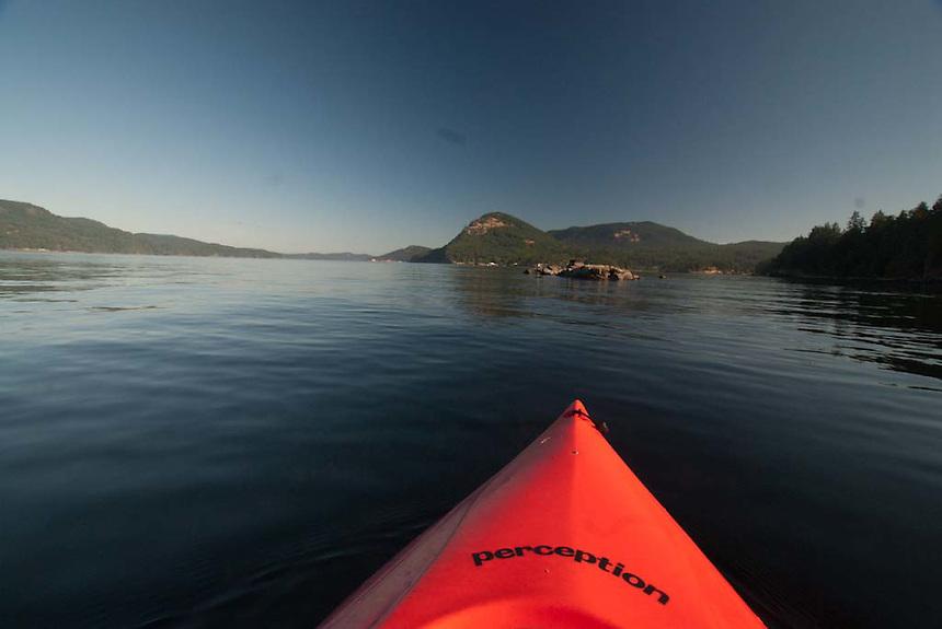 Kayaking at Obstruction Pass off Orcas Island, San Juan Islands, Washington, US
