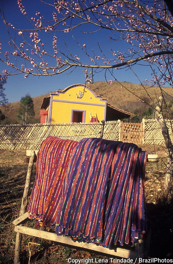 Chintz strips ( Tiras de chitão  ) , craftsmanship, brazilian yellow rural house Minas Gerais, Brazil. Colorful fabric, cloth, textile. Popular culture.