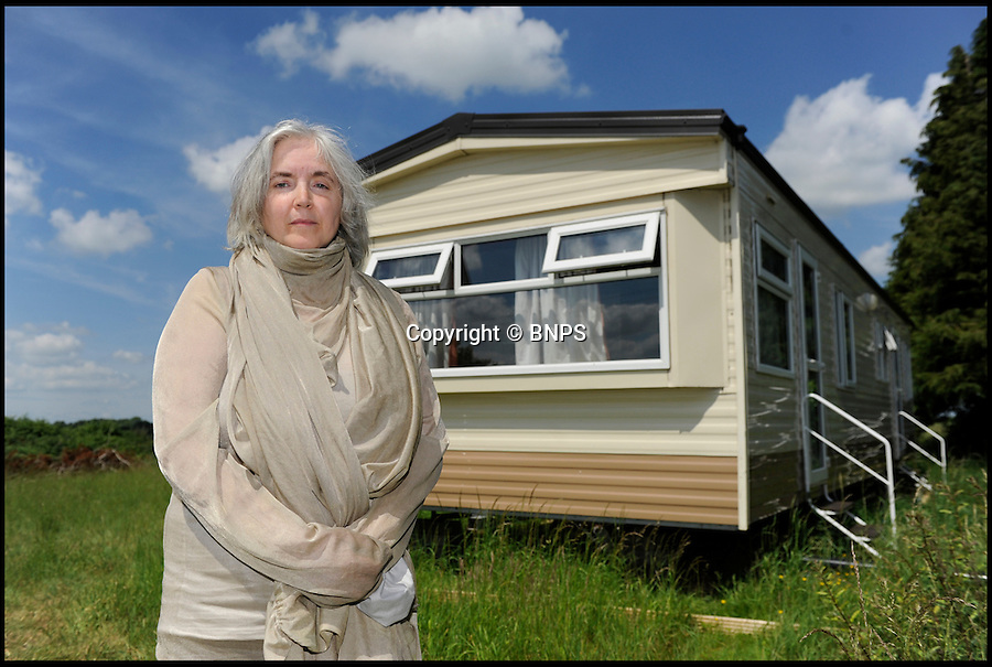 """BNPS.co.uk (01202 558833)<br /> Pic: TomWren/BNPS<br /> <br /> Meet the woman who is allergic to electricity.<br /> <br /> Jackie Lindsey, 50, doesn't have a mobile phone, television or laptop, she can no longer drive and she relies on candles for light and a gas cooker to boil water for a cuppa.<br /> <br /> When she does brave the outside world and all its technology, Jackie has to dress like a """"demented bee keeper"""" in a special suit which has silver woven into the fabric to reflect the magnetic fields around her.<br /> <br /> But she was living a normal life less than a decade ago, running rental properties in Liverpool, going travelling and enjoying activities like canoeing.<br /> <br /> Now she lives like a recluse, cut off from most of society and avoiding almost all technology in an attempt to battle her condition - electromagnetic hypersensitivity (EHS)."""
