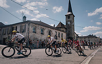 TdF peloton passing through the town with yellow jersey / GC leader Geraint Thomas (GBR/SKY) & GC favorite Chris Froome (GBR/SKY) up front<br /> <br /> 104th Tour de France 2017<br /> Stage 4 - Mondorf-les-Bains › Vittel (203km)