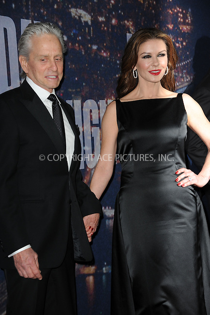 WWW.ACEPIXS.COM<br /> February 15, 2015 New York City<br /> <br /> Michael Douglas and Catherine Zeta-Jones walking the red carpet at the SNL 40th Anniversary Special at 30 Rockefeller Plaza on February 15, 2015 in New York City.<br /> <br /> Please byline: Kristin Callahan/AcePictures<br /> <br /> ACEPIXS.COM<br /> <br /> Tel: (646) 769 0430<br /> e-mail: info@acepixs.com<br /> web: http://www.acepixs.com