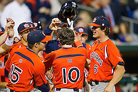 Dan Gamache #10 of the Auburn Tigers is congratulated by his teammates after hitting a 2-run home run against the Alabama Crimson Tide at Riverwalk Park on March 15, 2011 in Montgomery, Alabama.  Photo by Brian Westerholt / Four Seam Images