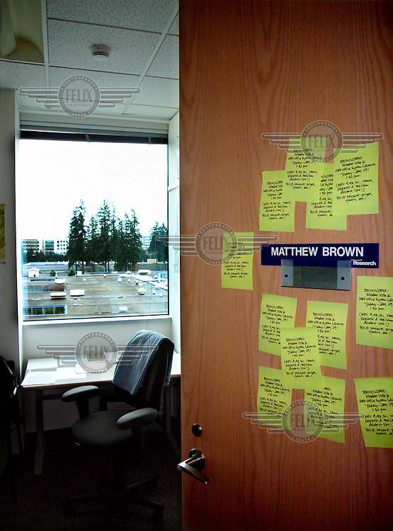 Mass-produced notes made to look hand-drawn stuck to the office door of a Microsoft employee.