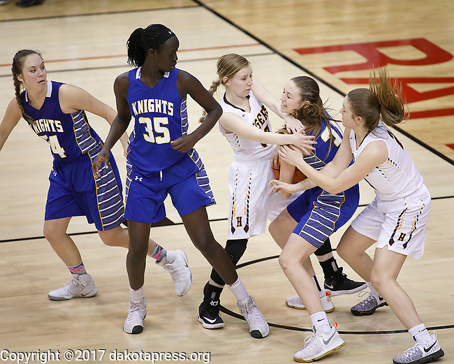 RAPID CITY, SD - MARCH 18, 2017 -- Bailey Pickerting #10 of Harrisburg reaches in and fouls Emma Ronsiek #31 of Sioux Falls O'Gorman in the final seconds of overtime in the 2017 South Dakota State Class AA Girls Basketball Championship game Saturday at Barnett Arena in Rapid City, S.D.  (Photo by Dick Carlson/Inertia)
