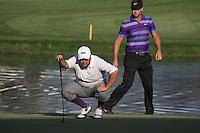 Joel Sjoholm (SWE) and Scott Jamieson (SCO) on the 18th hole during Sunday's Final Round of the 2012 Omega Dubai Desert Classic at Emirates Golf Club Majlis Course, Dubai, United Arab Emirates, 12th February 2012(Photo Eoin Clarke/www.golffile.ie)