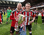 Sheffield United's Matt Done and Caolan Lavery celebrate with the trophy during the League One match at Bramall Lane, Sheffield. Picture date: April 30th, 2017. Pic David Klein/Sportimage