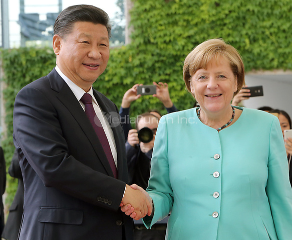 German chancellor Angela Merkel (CDU) receives the Chinese president Xi Jinping in the chancellery in Berlin, Germany, 5 July 2017. The Chinese president is visiting Berlin ahead of the G20 summit in Hamburg (7-8 July 2017). Photo: Wolfgang Kumm/dpa /MediaPunch ***FOR USA ONLY***