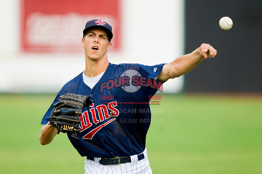 Elizabethton Twins starting pitcher Taylor Rogers #24 warms up in the outfield prior to the game against the Bluefield Blue Jays at Joe O'Brien Field on July 14, 2012 in Elizabethton, Tennessee.  The Twins defeated the Blue Jays 4-0.  (Brian Westerholt/Four Seam Images)