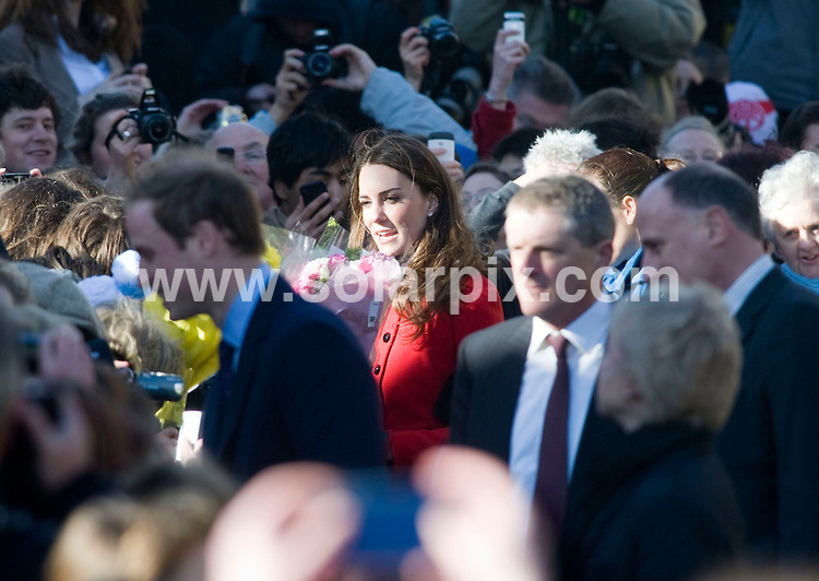 **ALL ROUND PICTURES FROM SOLARPIX.COM**                                             **NO UK NEWSPAPER PUBLICATION**.**UK MAGAZINE & SUPPLEMENT PUBLICATION ONLY** AND NO PUBLICATION IN AUSTRALIA, BELGIUM, FRANCE, GERMANY, ITALY, SCANDINAVIA AND USA**                                                                                  Caption: Kate Middleton greets the crowds as she arrives at St Andrews University in Scotland with Prince William. St Andrews, Scotland, UK. 25 February 2011.                                                                              This pic: Kate Middleton                                                                                             JOB REF: 12892 SFE       DATE: 25_02_2011                                                           **MUST CREDIT SOLARPIX.COM OR DOUBLE FEE WILL BE CHARGED**                                                                      **MUST AGREE FEE BEFORE ONLINE USAGE**                               **CALL US ON: +34 952 811 768 or LOW RATE FROM UK 0844 617 7637**