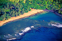 Aerial of secluded Kee Beach on Kauai's north shore, with beautiful white sand beach and plentiful coral reefs for snorkeling.