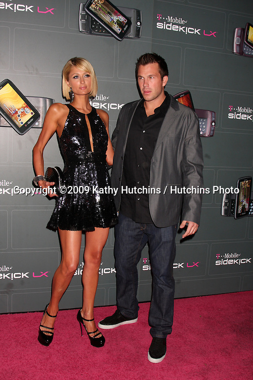 Paris Hilton & Doug Reinhardt  arriving at the  T-Mobile Sidekick LX Launch Event at  Paramount Studios in.in Los Angeles, CA on May 14, 2009 .©2009 Kathy Hutchins / Hutchins Photo...                .