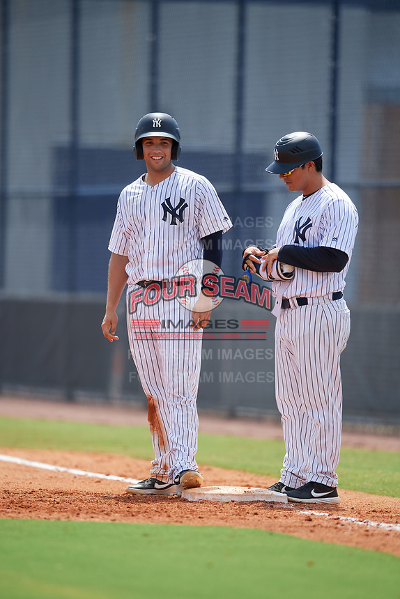 GCL Yankees East Raymundo Moreno (left) and coach Hector Rabago (right) during a Gulf Coast League game against the GCL Phillies East on July 31, 2019 at Yankees Minor League Complex in Tampa, Florida.  GCL Yankees East defeated the GCL Phillies East 11-0 in the first game of a doubleheader.  (Mike Janes/Four Seam Images)