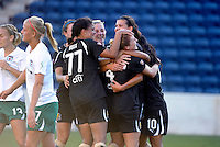 FC Gold Pride midfielder Shannon Boxx (77) gives a pat on the head to teammate Rachel Buehler (4) after Buehler headed in the Pride's second goal.  The FC Gold Pride defeated the Chicago Red Stars 3-2 at Toyota Park in Bridgeview, IL on August 22, 2010