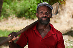 A year after Hurricane Matthew ravaged parts of Haiti, Comfere Renel pauses as he and his neighbors work on a dike they have built in the community of Bassin Hady, a village in the country's drought-stricken northwest where seven people died during the storm. In the wake of the hurricane, residents here constructed a series of earthen dikes that catch and hold rain water, preventing soil erosion and providing water for expanded agriculture. They did it with help from Lutheran World Relief, one of several members of the ACT Alliance that are helping Haitians build resiliency as they rebuild from the storm.