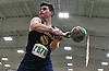 Joe Ryan of Massapequa generates momentum for a weight throw during the event's Nassau County championship and state qualifier at St. Anthony's High School on Monday, Feb. 6, 2017.