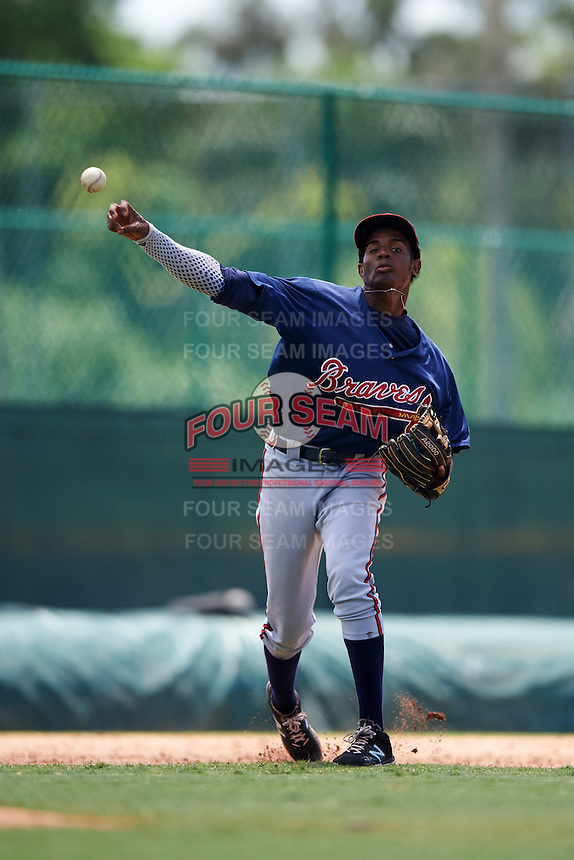 GCL Braves third baseman Alex Aquino (1) throws to first during a game against the GCL Pirates on August 10, 2016 at Pirate City in Bradenton, Florida.  GCL Braves defeated the GCL Pirates 5-1.  (Mike Janes/Four Seam Images)