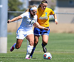 BROOKINGS, SD - AUGUST  22: Diana Potterveld #7 from South Dakota State University battles for the ball with Katie Schulz #13 from Green Bay in the second half of their game Sunday afternoon at Fischback Soccer Field in Brookings. (Photo by Dave Eggen/Inertia)