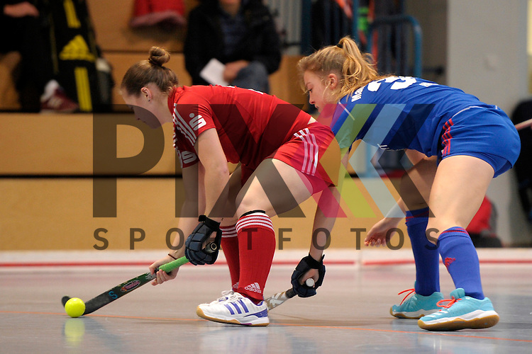 GER - Mannheim, Germany, December 19: During the 1. Bundesliga Sued Damen indoor hockey match between Mannheimer HC (blue) and Nuernberger HTC (red) on December 19, 2015 at Irma-Roechling-Halle in Mannheim, Germany.  Nina Meller #22 of Nuernberger HTC, Antonia Hering #34 of Mannheimer HC<br /> <br /> Foto &copy; PIX-Sportfotos *** Foto ist honorarpflichtig! *** Auf Anfrage in hoeherer Qualitaet/Aufloesung. Belegexemplar erbeten. Veroeffentlichung ausschliesslich fuer journalistisch-publizistische Zwecke. For editorial use only.