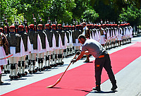 Pictured: A Council street sweeper makes sure that the red carpet remains spotless moments before the arrival of French President Emmanuel Macron at the Presidential Mansion in Athens, Greece. Thurday 07 September 2017<br /> Re: The official welcome of French President Emmanuel Macron for his state visit to Athens, Greece.