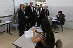 """Palestinian Prime Minister Mohammad Ishtayeh visits a school during the first day of high school exams, known as """"Tawjihi"""" in the West Bank city of Ramallah on June 8, 2019. More than 76130 students in the West Bank and Gaza Strip start Saturday their Tawjihi exam that qualifies them to enter college. Photo by Prime Minister Office"""