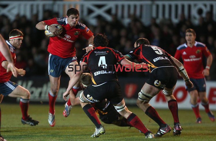 The Dragons defence lines up to stop the charging Munster center James Downey.<br /> RaboDirect Pro12<br /> Newport Gwent Dragons v Munster<br /> Rodney Parade - Newport<br /> 29.11.13<br /> ©Steve Pope-SPORTINGWALES